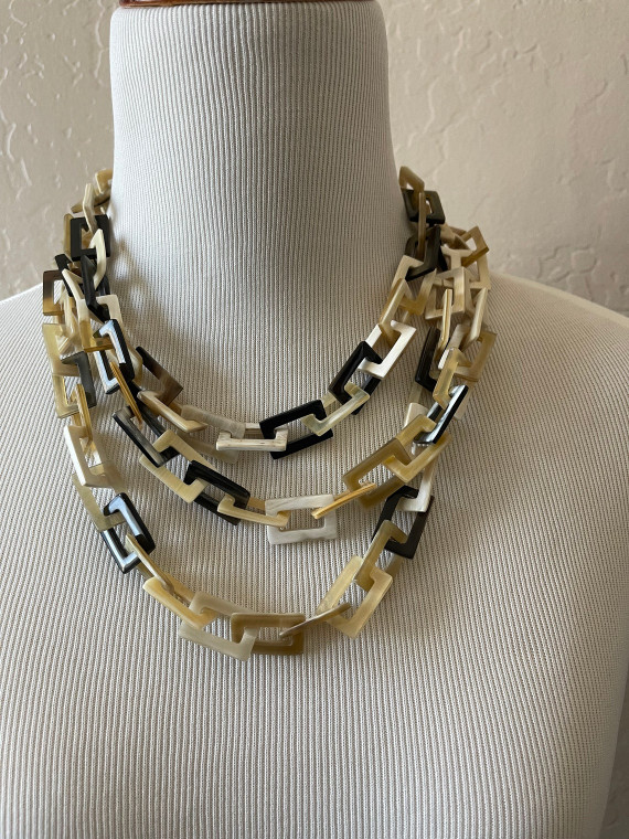 Fabulous necklace for fall and winter. Made in Vietnam for LifeXplore, this interlocking geometric rectangle bead necklace can be worn long, double or triple. Very retro 1970's.