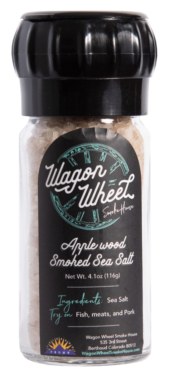 Apple Wood Smoked Sea Salt is made using a medium course sea salt that is placed on screens and slow smoked for six hours. This sea salt comes in a reusable glass grinder when a smaller grind is desired. Smoking salt brings out a mild smoky flavor in the salt. All of our smoked salt is made using local Colorado Apple Wood. Smoked sea salt is widely used a finishing salt for use on anything from salad, meats, eggs, or as a replacement for regular table salt.   Ingredients- Salt