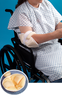 A patient in a wheelchair with the Elbowlift® Suspension Pad protecting the sensitive skin from friction