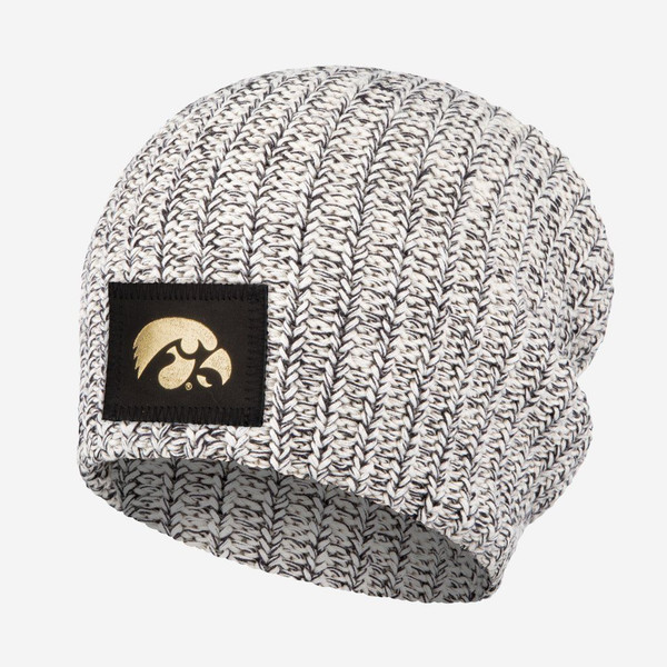 This black speckled beanie features a black leather patch with the University of Iowa logo in gold foil on the front. These beanies are incredibly cozy and have a slouchier fit.