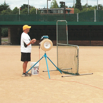 JUGS BP®1 Pitching Machine used by a coach behind a screen on a baseball field