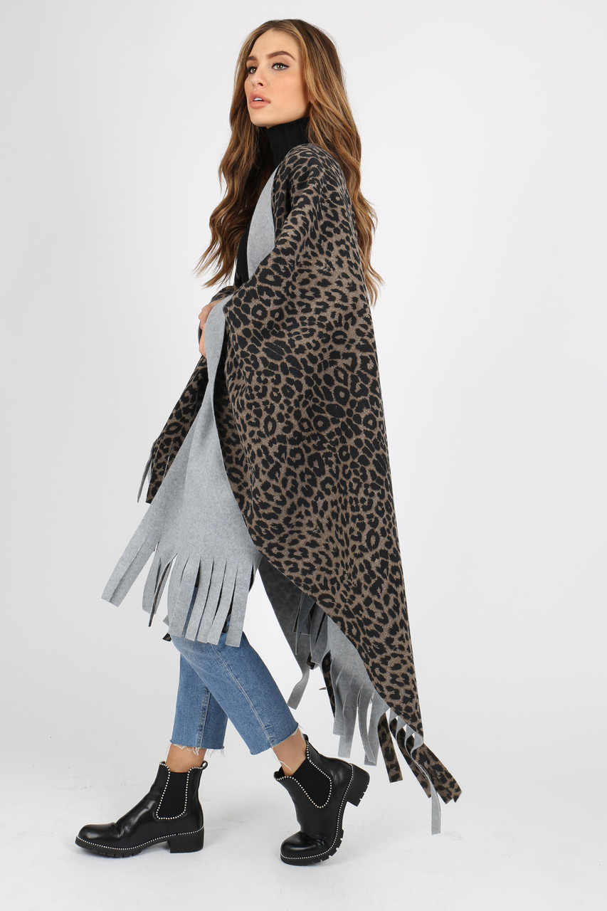 ANIMAL PONCHO WITH TASSEL ENDS