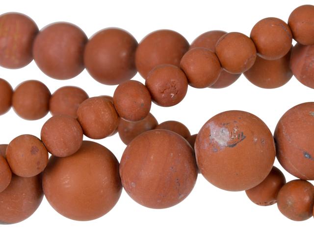 Image of matte red jasper gemstones