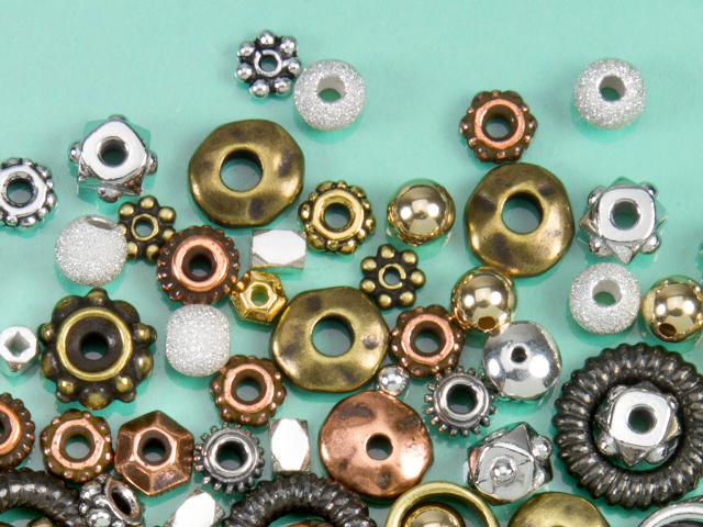 Image of differen spacer beads in various sizes, shapes, and finishes