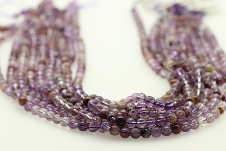Super 7, Melody Stone, Purple, Natural, Smooth Round in sizes 4mm, 6mm, 8mm & 10mm