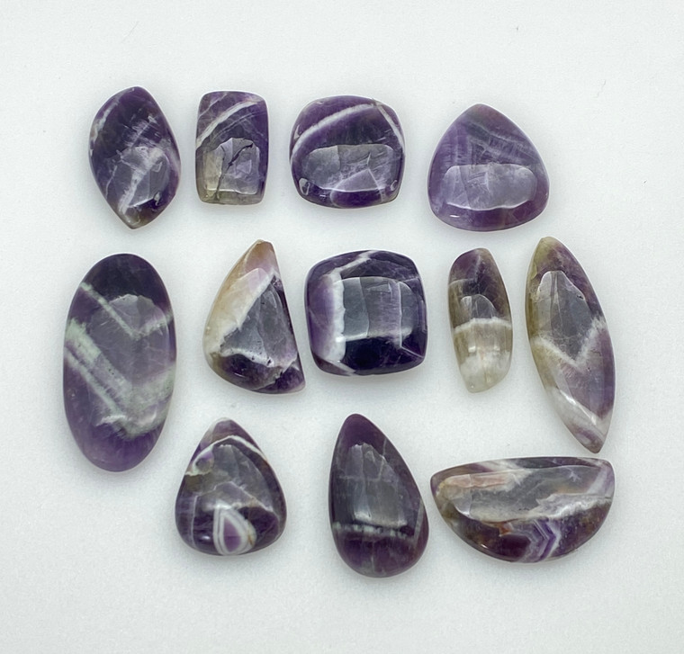 Chevron Amethyst Cabochons 100g Lot of assorted sizes and shapes.