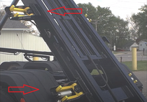Dumpster container tie down system.