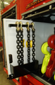 Slide out chain board for storing chains