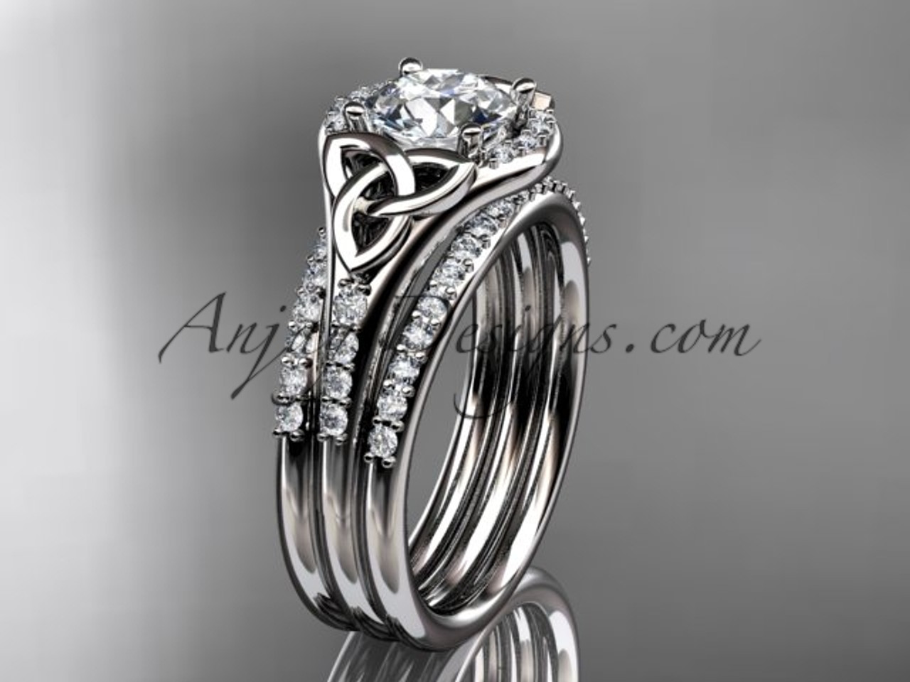 It is a photo of 50kt white gold diamond celtic trinity knot wedding ring, engagement ring with a double matching band CT50S
