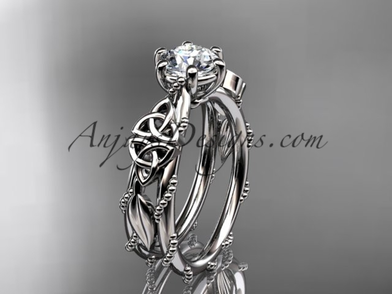 14kt White Gold Celtic Trinity Knot Engagement Ring Wedding Ring With A Forever One Moissanite Center Stone Ct766
