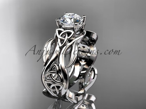 """platinum celtic trinity knot wedding ring, engagement ring with a """"Forever One"""" Moissanite center stone CT7264"""