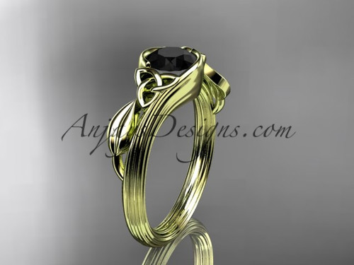 14kt yellow gold celtic trinity knot wedding ring, engagement ring with a Black Diamond center stone CT7324