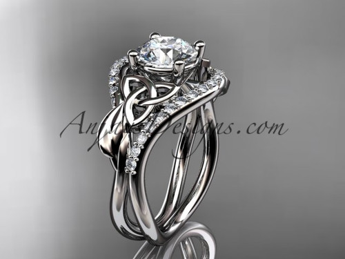 """14kt white gold diamond celtic trinity knot wedding ring, engagement ring with a """"Forever One"""" Moissanite center stone CT7244"""