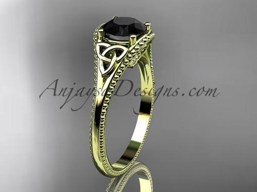 14kt yellow gold celtic trinity knot wedding ring, engagement ring with a Black Diamond center stone CT7375