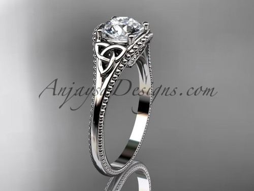 "14kt white gold celtic trinity knot wedding ring, engagement ring with a ""Forever One"" Moissanite center stone CT7375"