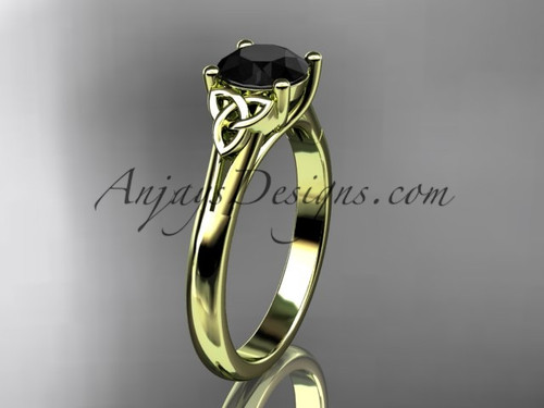 14kt yellow gold celtic trinity knot wedding ring with a Black Diamond  center stone CT7154