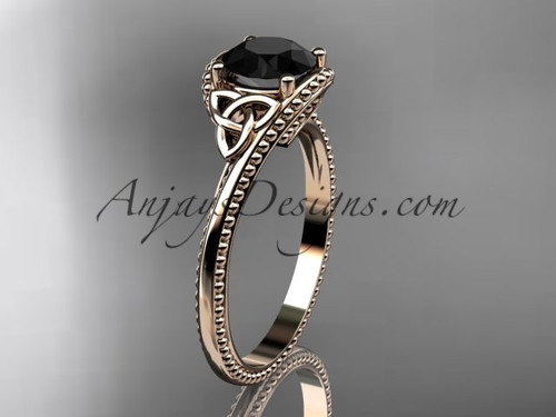 14kt rose gold celtic trinity knot wedding ring, engagement ring with a Black Diamond center stone CT7322