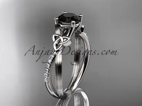 platinum diamond celtic trinity knot wedding ring, engagement ring with a Black Diamond center stoneCT7214