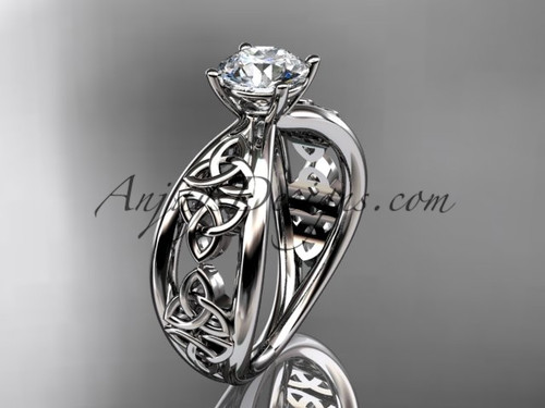 """14kt white gold celtic trinity knot wedding ring, engagement ring with a """"Forever One"""" Moissanite center stone CT7171"""