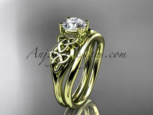 "14kt yellow gold celtic trinity knot wedding ring, engagement set with a ""Forever One"" Moissanite center stone CT7169S"