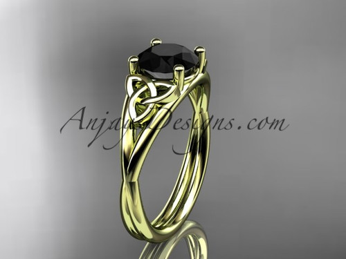 14kt yellow gold celtic trinity knot wedding ring, engagement ring with a Black Diamond center stone CT7189
