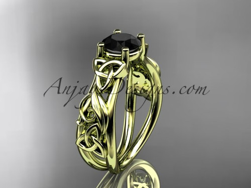 14kt yellow gold celtic trinity knot  wedding ring, engagement ring with a Black Diamond center stone CT7216
