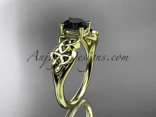 14kt yellow gold celtic trinity knot wedding ring, engagement ring with a Black Diamond center stone CT7169