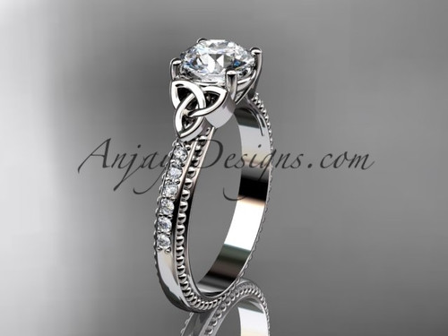 """14kt white gold diamond celtic trinity knot wedding ring, engagement ring with a """"Forever One"""" Moissanite center stone CT7391"""