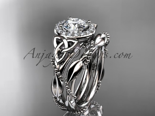 """platinum diamond celtic trinity knot wedding ring, engagement set with a """"Forever One"""" Moissanite center stoneCT7328S"""