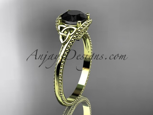 14kt yellow gold celtic trinity knot wedding ring, engagement ring with a Black Diamond center stone CT7322