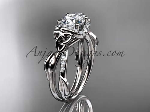"""14kt white gold diamond celtic trinity knot wedding ring, engagement ring with a """"Forever One"""" Moissanite center stoneCT7274"""