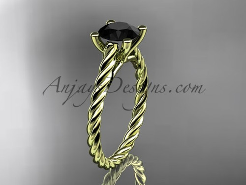 14kt yellow gold twisted rope wedding ring  with a Black Diamond center stone RP8116