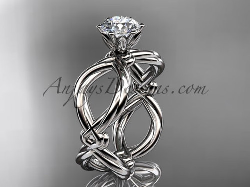 """Platinum twisted rope engagement ring with a """"Forever One"""" Moissanite center stone RP8192"""