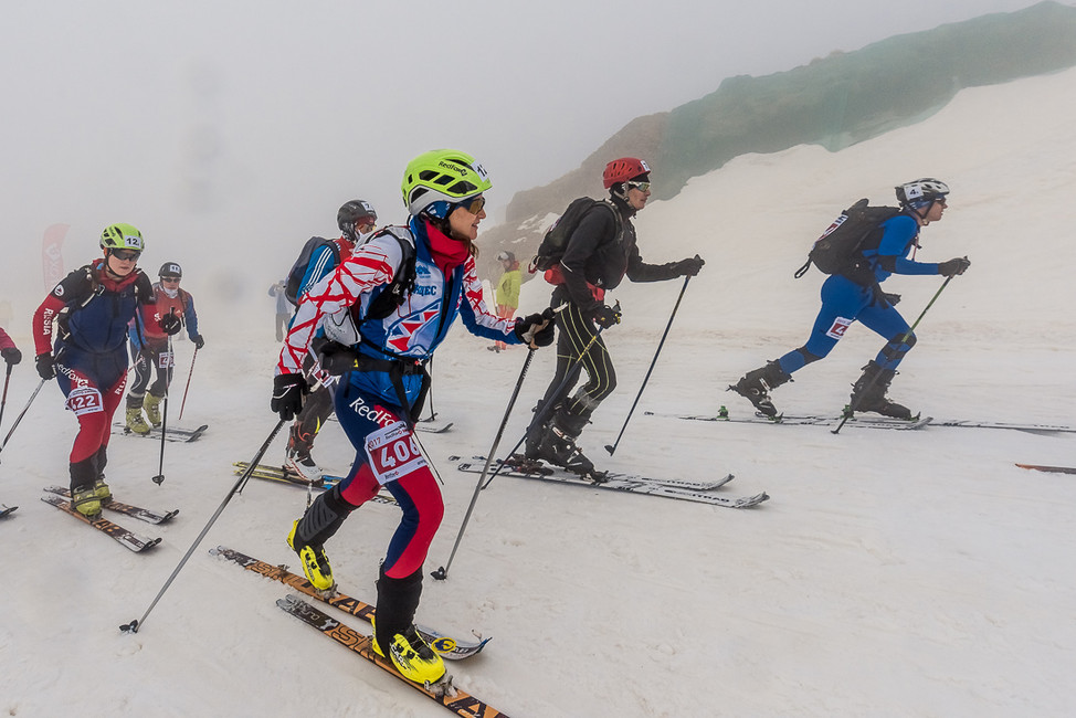 Ski-mountaineers continue competing in a team race