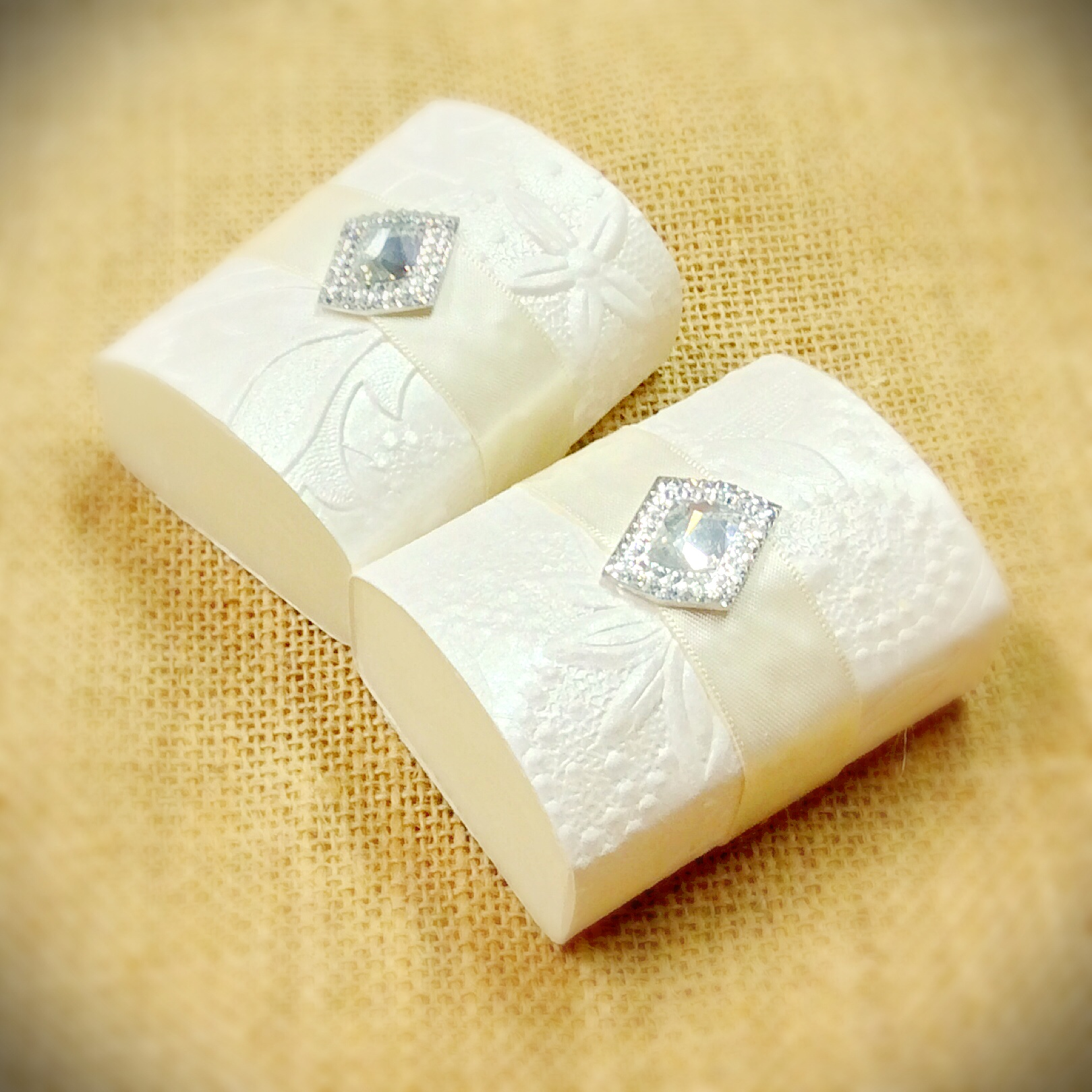wedding-or-event-favor-of-1-large-goats-milk-soap-with-embossed-paper-and-embellishment-on-top.jpg