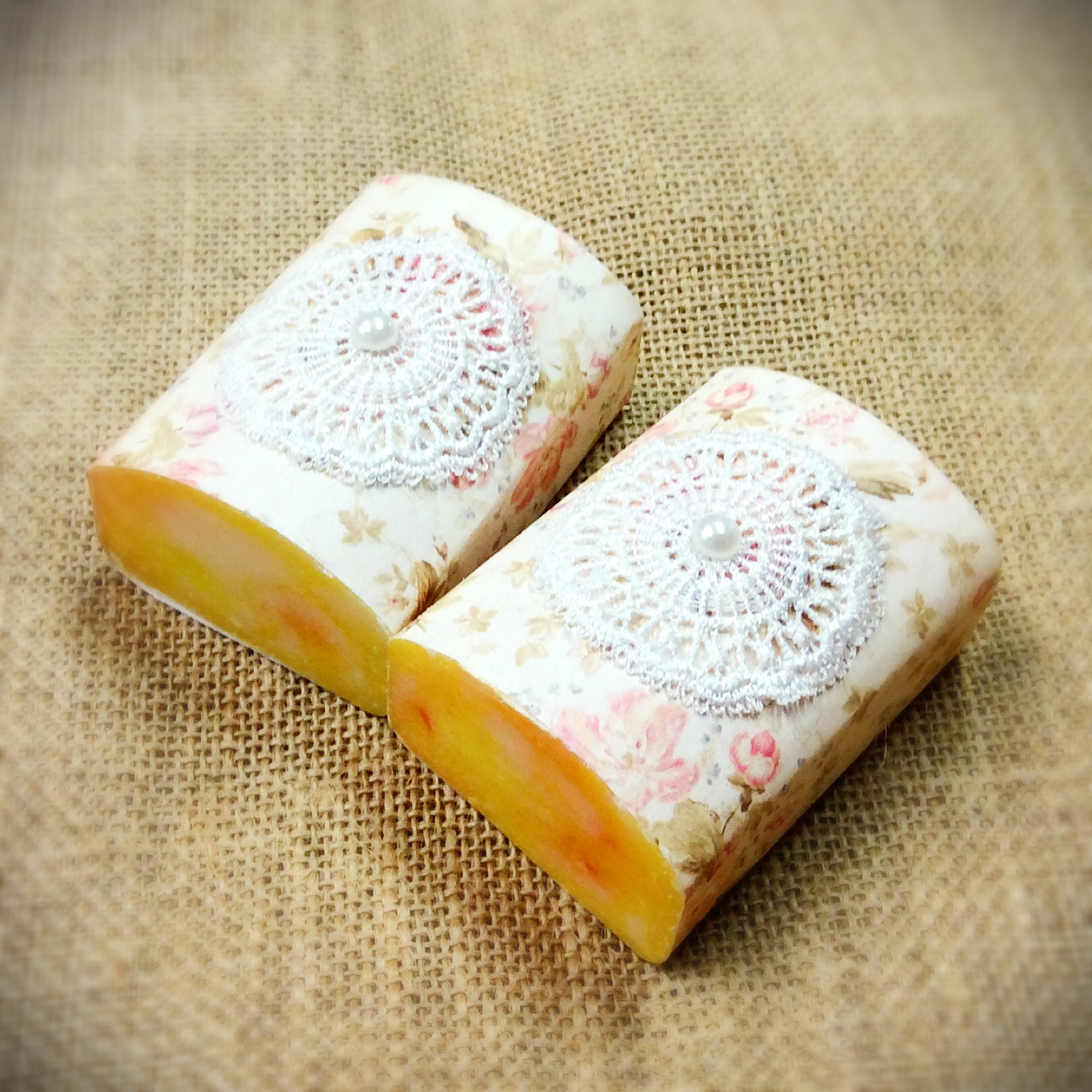 wedding-or-event-favor-of-1-large-goats-milk-soap-with-floral-print-paper-and-doily-on-top.jpg