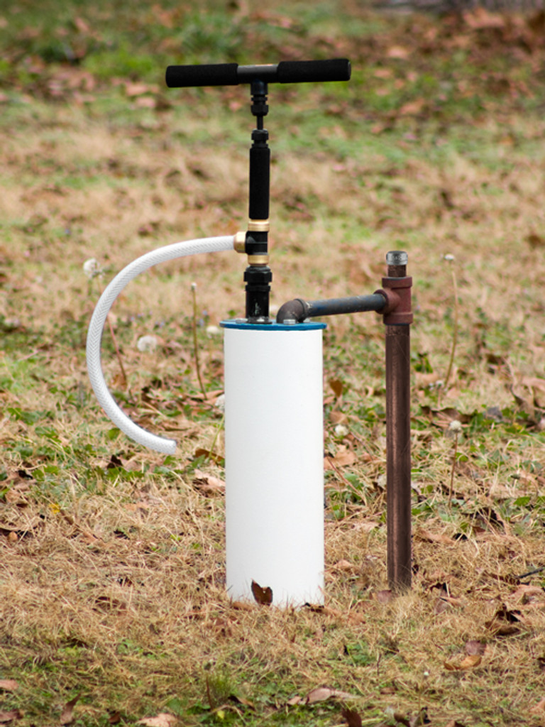 View of EarthStraw System installation using the Mounting Bracket on a cast iron well seal.