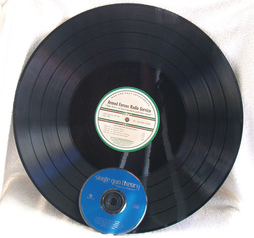 Compare the sizes! Standard modern CD sitting with one of these 16 inch transcription records