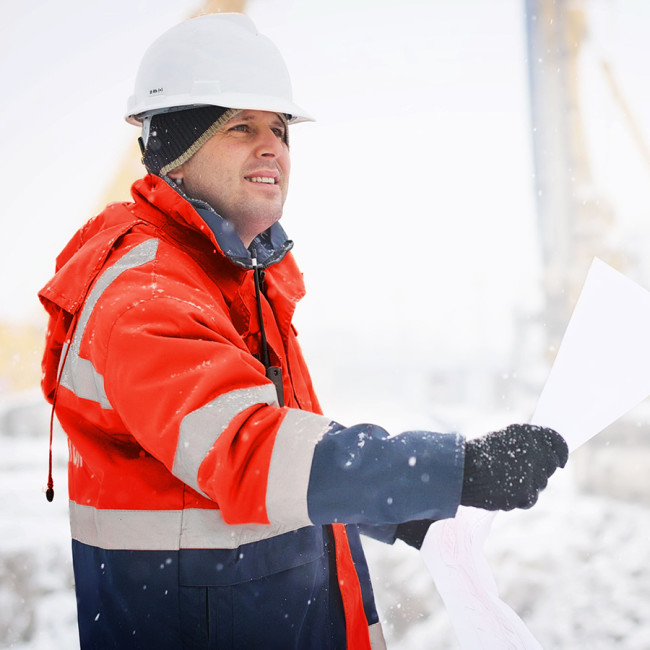 Construction engineer wearing ewool® PRO heated vest under his coat