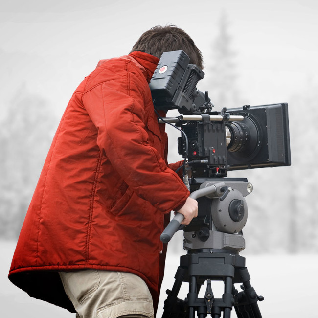 Professional filmmaker wearing ewool® PRO heated vest under his coat