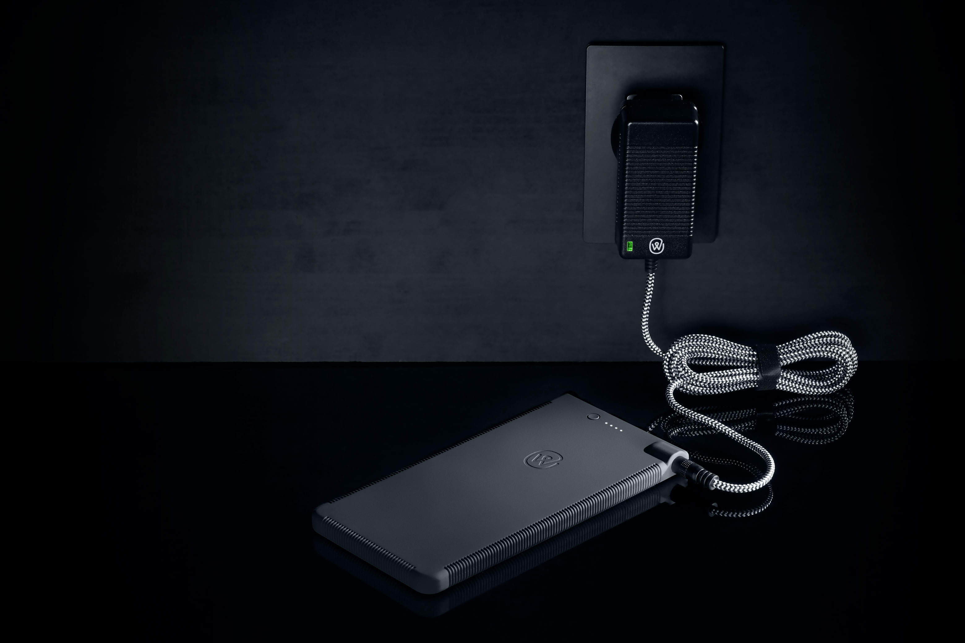 ewool® battery with 32W charger plugged on a wall