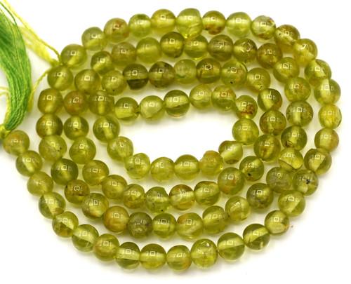 """14"""" Strand Approx. 4-5mm Peridot Hand-Cut Beads"""