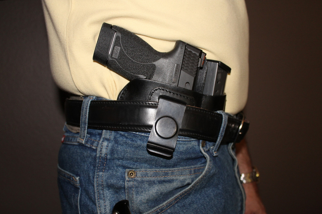 Waistband concealment holster on model