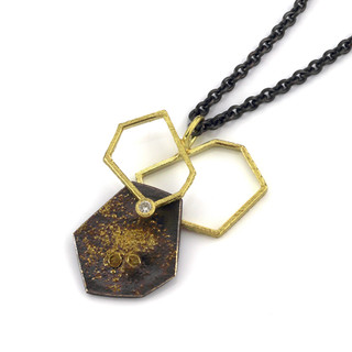 Geometric frame pendant by Liaung-Chung Yen | 18K yellow gold and oxidized sterling silver