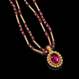 Modern Art Jewelry   Rubellite Cabochon set in a Hand-Fabricated 22 Karat Gold Bezel   Ruby and 18 Karat Gold Beads   Granulation