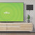 mohu leaf 50 TV antenna on a wall next to a TV in a living room