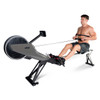 Model working out with Velocity Exercise Vantage Programmable Rower