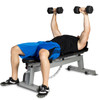 Model dumbbell pressing on the Model using resistance bands with the CAP Deluxe Utility Bench in flat position