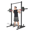 Model squatting with CAP Strength Power Rack Exercise Stand