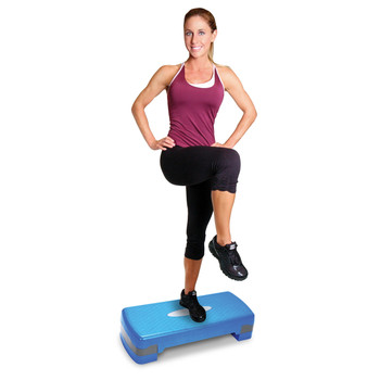 Model stepping on Tone Fitness Aerobic Stepper